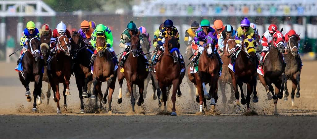 LOUISVILLE, KY - MAY 03:  Jockey Victor Espinoza guides California Chrome #5 to the finish line to win the 140th running of the Kentucky Derby at Churchill Downs on May 3, 2014 in Louisville, Kentucky.  (Photo by Rob Carr/Getty Images)