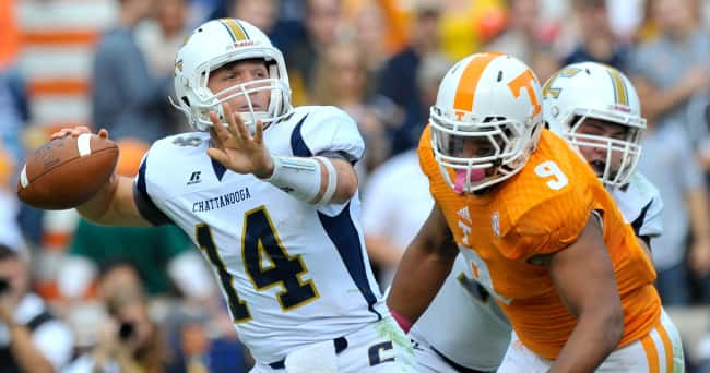 Oct 11, 2014; Knoxville, TN, USA; Tennessee Volunteers defensive end Derek Barnett (9) rushes in for the sack on Chattanooga Mocs quarterback Jacob Huesman (14) during the first half at Neyland Stadium. Mandatory Credit: Jim Brown-USA TODAY Sports