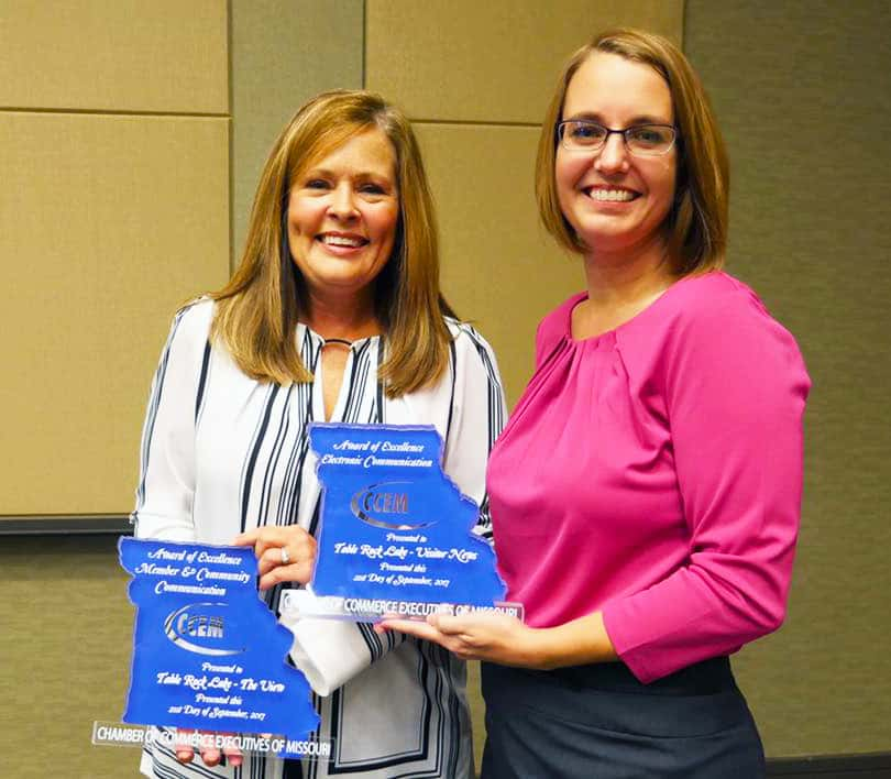 Sheila Thomas, Table Rock Lake Chamber Of Commerce President/CEO, Accepts  Two Awards From CCEM President Victoria Brees.