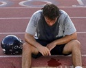 McClintock High School Chargers football player Joe Sanford takes a break from practice after feeling light-headed in Tempe, Arizona August 4, 2011. REUTERS/Joshua Lott