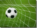 Soccer ball into net image