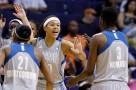 Minnesota Lynx's Seimone Augustus, middle, celebrates with Renee Montgomery (21) and Natasha Howard (3) as the Lynx take an early lead against the Phoenix Mercury during the first half of a WNBA basketball game Wednesday, May 25, 2016, in Phoenix. (AP Photo/Ross D. Franklin)