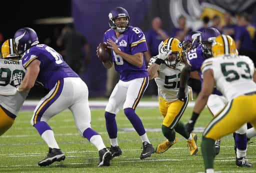 Minnesota Vikings quarterback Sam Bradford (8) throws a pass during the first half of an NFL football game against the Green Bay Packers, Sunday, Sept. 18, 2016, in Minneapolis. (AP Photo/Andy Clayton-King)