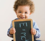 Mixed Race baby holding chalkboard