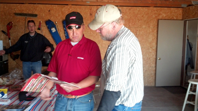 Sponsor Mark Muench of Muench AgriSolutions talks Salford tillage equipment with Rick Ibben, son of Week 1 winner Wayne Ubben.