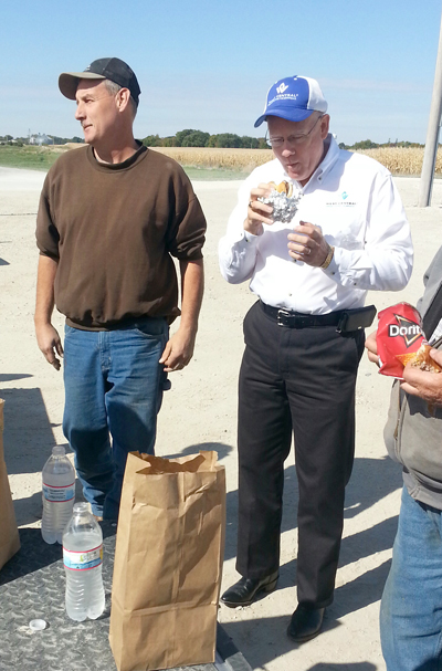 West Central Cooperative Board Member Jim Carlson (left) introduces CEO Milan Kucerak to area farmers at the Harvest-Cooperative Month sack lunch at the Gowrie location.