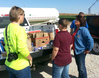Preparing the Lunches at the West Central Cooperative farmer appreciation sack lunch event at the Gowrie location. Alicia Clancy (left), Jessica Lomicka, Deb Hess & Josh Crouch (at the grill).