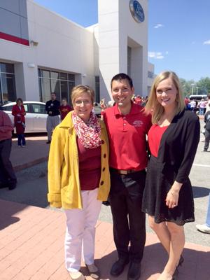 Kim Wetzel with Matt and Abigail Johnson of Fort Dodge Ford.