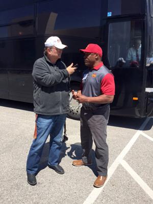 Mike Devine talking to Kevin Jackson, ISU Wrestling Coach.