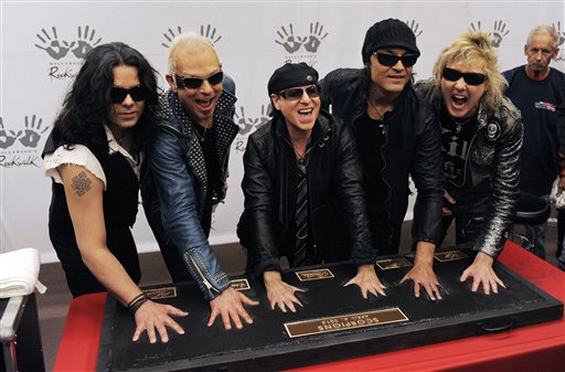 The German rock band The Scorpions, from left, Pawel Maciwoda, Rudolf Schenker, Klaus Meine, Matthias Jabs and James Kottak put their hands in cement as they are inducted into the Hollywood Rockwalk in Los Angeles, Tuesday, April 6, 2010. (AP Photo/Chris Pizzello)