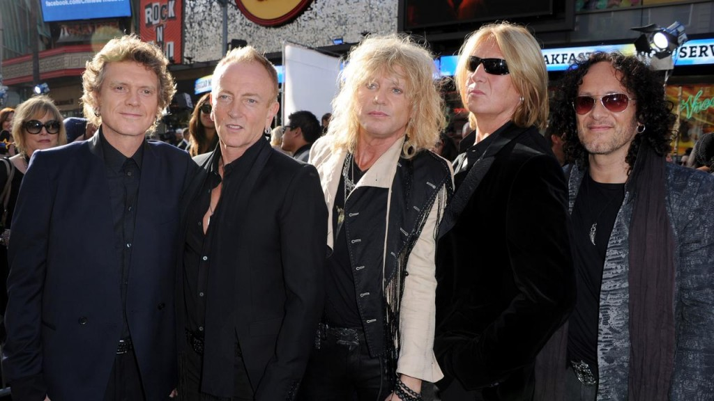 """HOLLYWOOD, CA - JUNE 08: (L-R) L-R) Musicians Rick Allen, Phill Collen, Rick Savage, Joe Elliott and Vivian Campbell of Def Leppard arrive at the premiere of Warner Bros. Pictures' """"Rock of Ages"""" at Grauman's Chinese Theatre on June 8, 2012 in Hollywood, California. (Photo by Kevin Winter/Getty Images)"""