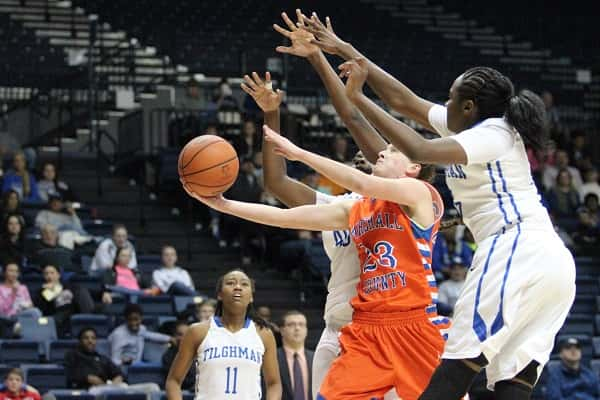 Michaela Manley was covered up by the Tilghman defense in this attempt and led the Lady Marshals with 14 points.