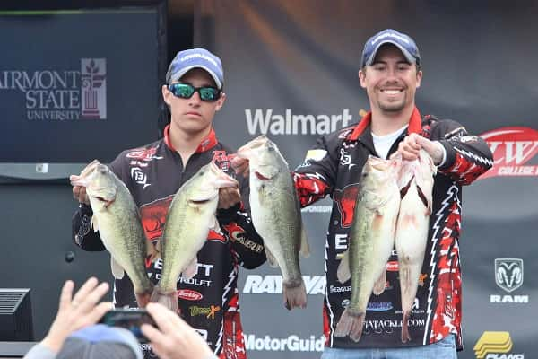The University of Arkansas-Fayetteville team of Zachery Pickle (left) and Drew Porto show off Saturday's catch of 21-15 that gave them the FLW College Fishing Kentucky Lake Open win with a two-day total of 43-12.