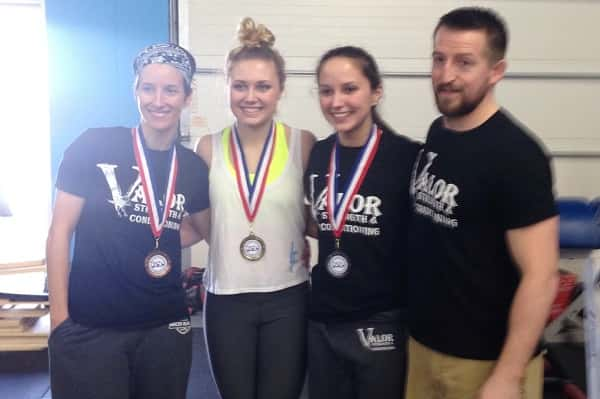 Pictured left to right, Cassie Fleming, Karson Johnson, Katie Darnall and their coach Josh Hendrickson at the Kentucky State Weightlifting Championship.
