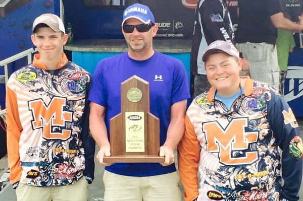 Colton Story (left) and Peyton Porter (right) along with boat captain Jeff Story, following their Region 1 Championship.