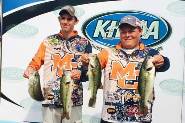 Colton Story (left) and Peyton Porter showing off their fish from Friday's first day of the KHSAA State Bass Fishing Tournament at Kentucky Dam Marina.
