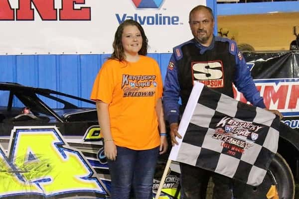 Tim Brown poses with KLMS trophy girl Hannah Morrison in victory lane after his Late Model win.