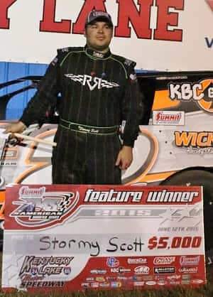Stormy Scott poses with symbolic $5,000 check in victory lane.