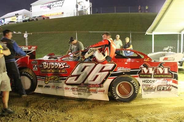 Tanner English climbs from his car after taking the Crate Late Model feature.