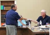 "Randy Newcomb passed out information to the Fiscal Court about ""The South's Great Lake Fish Festival"" event in September."