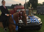 Mia Jaco and her horse, Milo, pose with the blue ribbons and trophy they won Aug. 25.