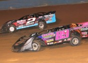 Credence Mott (89) goes under Adam Ray (2) in the Pro Crate Late Model feature.
