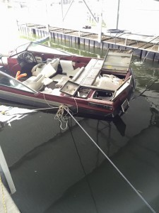 Emergency personell recover sunken vessel at KenLake Marina on Saturday.
