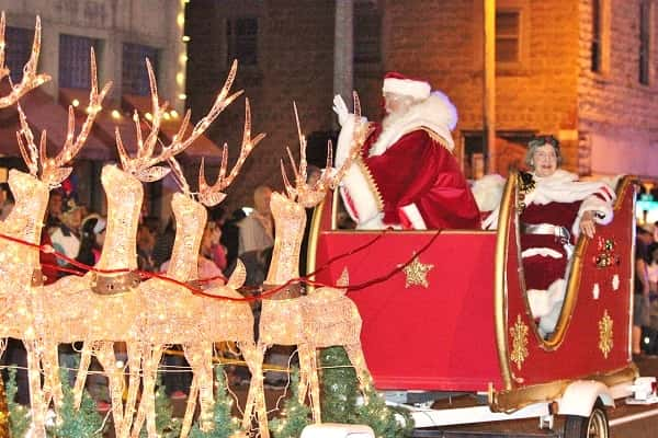 the arrival of santa and mrs claus wrapped up the annual christmas parade in benton - Dickens Christmas Festival