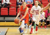 Miyah Davis dishes the ball off under the goal in the Lady Marshals 55-28 win over Calloway County.