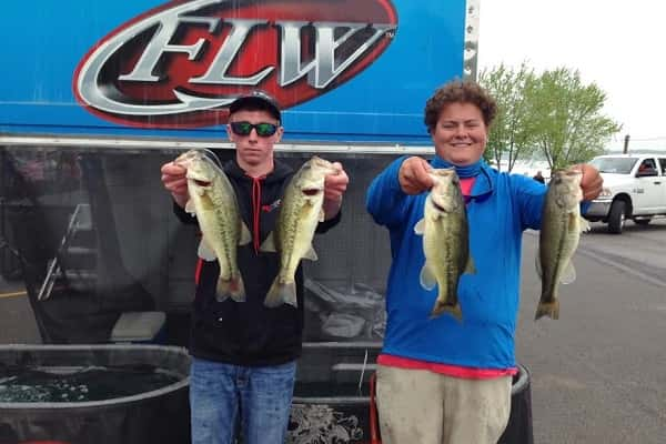 Barrett Washburn (left) and Peyton Porter show off their catch that earned them a spot in the KHSAA State Bass Fishing Tournament.