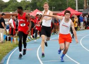 Jackson Brown hands off to Will McGee in a relay event Friday at McCracken County.