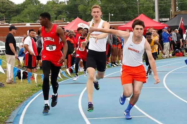 Jackson Brown hands off to Will McGee in a relay event Friday at McCracken County. All photos courtesy of Steve Feeney (www.stevefeeney.photography)