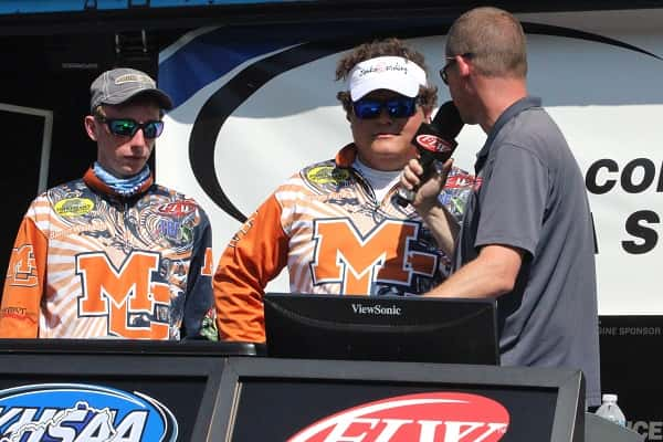 Marshall County's Barrett Washburn (left) and Peyton Porter (center) at Friday's weigh-in after Day 1 of the KHSAA State Bass Fishing Championship.