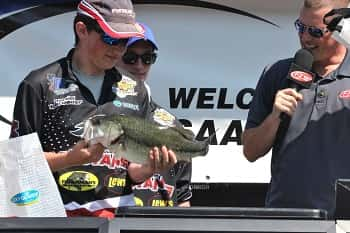 McCracken County's Daniel Schroeder shows off the 5-11 Big Bass they caught on Kentucky Lake at Friday's weigh-in.