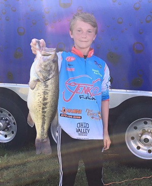 Miles McManus shows off the 6-15 bass that won him the Biggest Bass Award.
