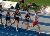 Collin Gunn on the track running the 1600 meters in Saturday's KHSAA State Track and Field Championships.