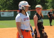 Addie Young standing on 3rd base following her 2-run triple that gave the Lady Marshals a 3-1 win over the Lady Bombers.