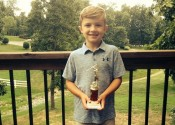 Cruz Cocke proudly holds his trophy from the 2016 Junior Red Bird Tournament at Calvert City Country Club.