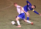 Parker Jennings battled Graves County's Brady Wetherington for ball control in Tuesday's district match-up.