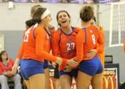 The Lady Marshals celebrate their 3rd set win in Thursday's district rivalry game against CFS.