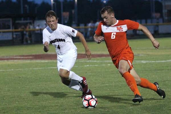 Dawson Jolley controls the ball, defended by McCracken's Owen Lacey, in the Marshals 4-3 win over the Mustangs Tuesday.