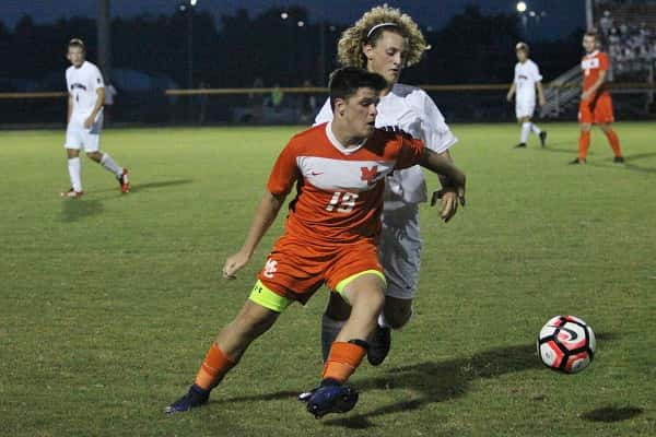 Austin Stockdale blocks out McCracken's Rady Hall to maintain control of the ball.