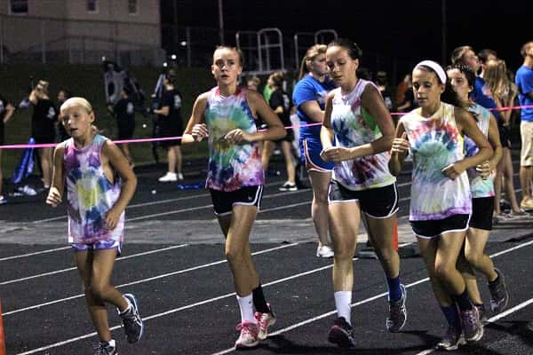 Cross country runners circled the track in the annual Run-A-Thon fundraiser at a home football game a couple years ago.