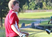 Logan Draffen watches his tee shot in a match last season at Calvert City Country Club.