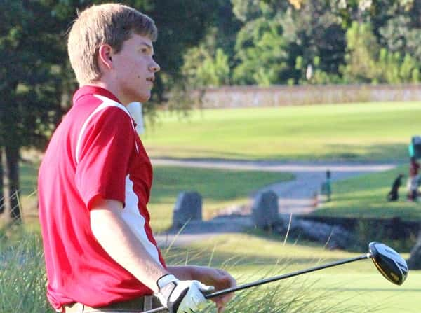 Logan Draffen watches his tee shot in a match last season at Calvert City Country Club.