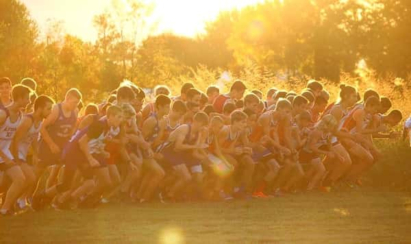 A great shot of the boy's start at dusk at the Mad Marshal Dash by Marshall County Cross Country.