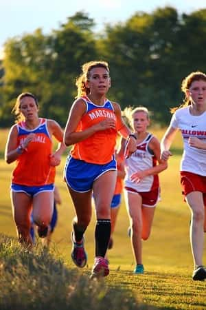 Haley Ford (right) and Chloe Kerrick (left) in the girl's varsity race. Photo courtesy of MCHS XC.