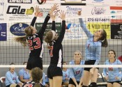 Abigail Cima (23) and Maggie Wagner (7) work together to block Calloway's Carson Mayes.
