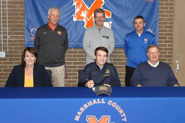 Quinn Eaton signed his National Letter of Intent joined by his parents Marci and Jim Eaton and standing (L-R) coaches Keith Bell, Todd Trimble and Brent Lovett.