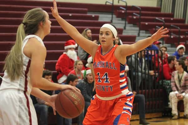 Lexee Miller (14) and the Lady Marshal defense, held McCracken County to 17 points in Paducah on Friday.